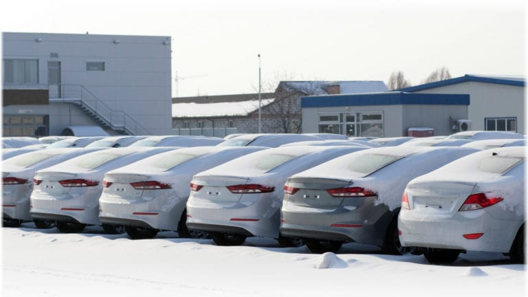 cars in dealership after winter storm